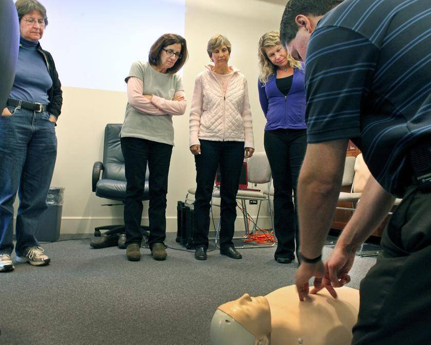 EMT AndrewGleckel demonstrates CPR during a basic training session for Medical Reserve Corps volunteers held last month in Weston.